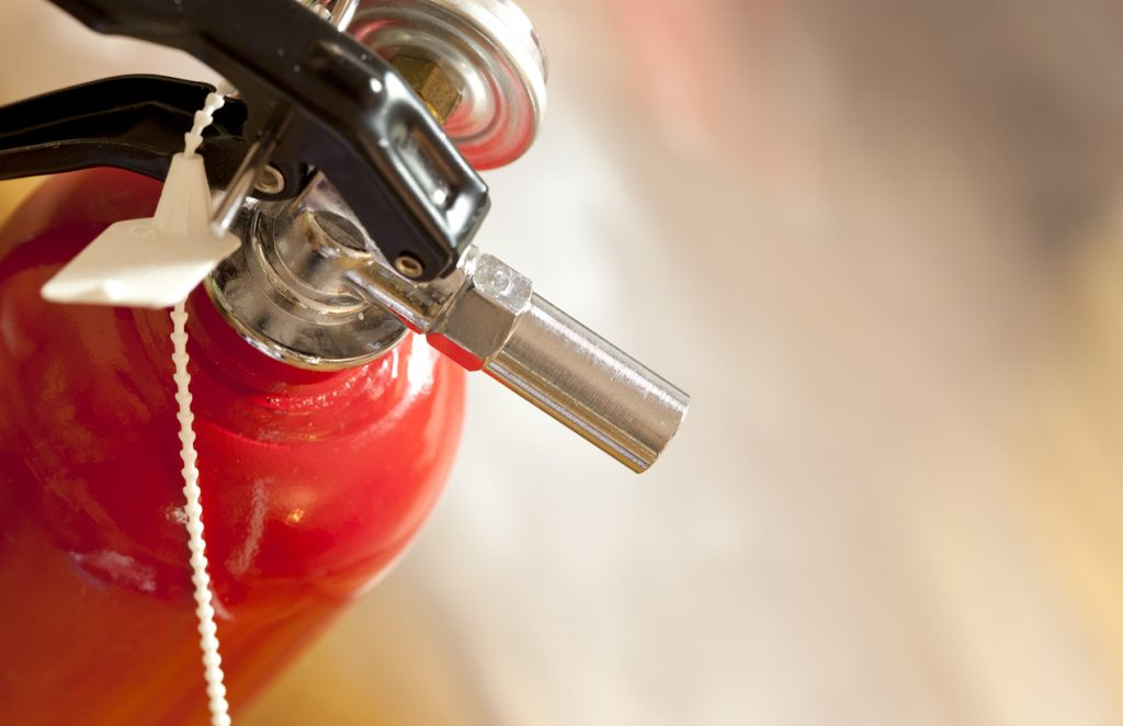 studio shot of fire extinguisher