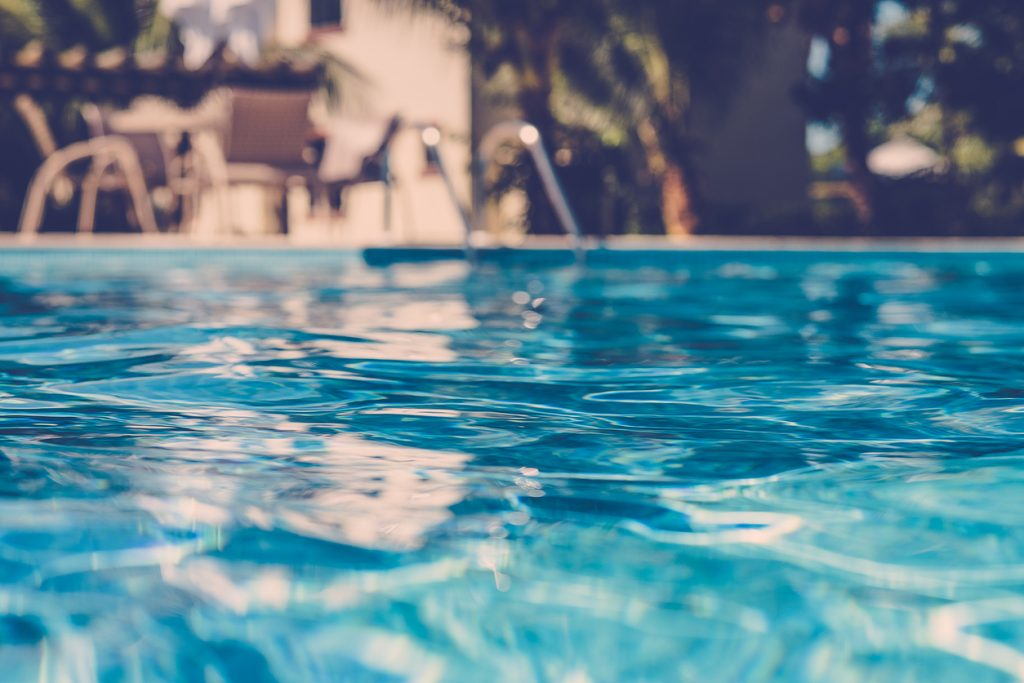 blurred surface view on blue swimming pool